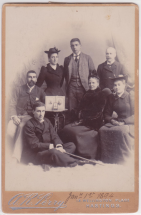 Calderon family photograph, 1 January 1894. Clockwise: seated on floor George Calderon, Jack Calderon, Marge Calderon, Fred Calderon, Alfred Merigon Calderon, Evelyn Calderon, seated next to table Clara Calderon.